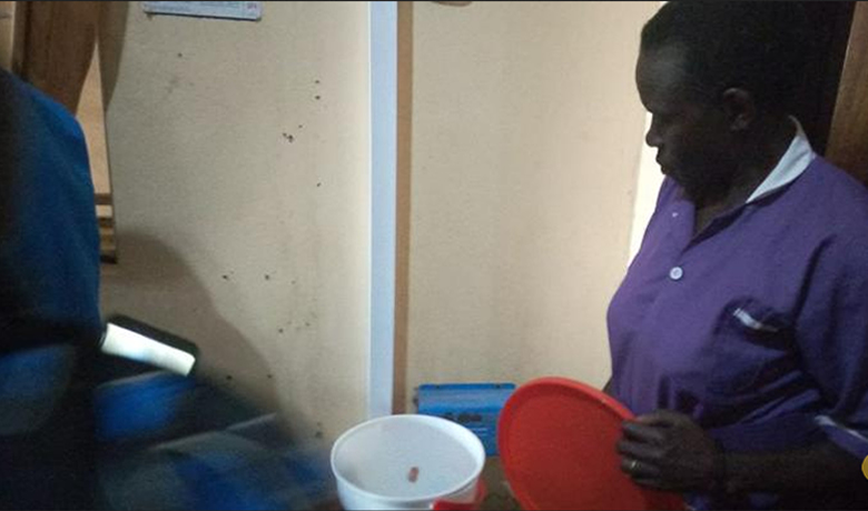 Arua Nurse Shows the Frog Found in Woman Placenta